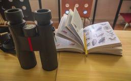 Bionoculars with Bird Guide. Binoculars with Bird Guide Bird watching Ornithology royalty free stock photo