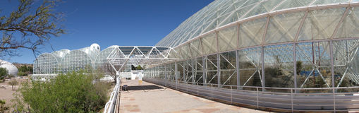 BioSphere 2 - Panorama. A panoramic view of the structure at Biosphere 2 - It is located north of Tucson, Arizona at the base of the stunning Santa Catalina royalty free stock image