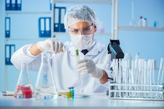 The biotechnology concept with scientist in lab. Biotechnology concept with scientist in lab Royalty Free Stock Images