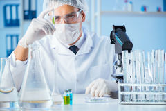 The biotechnology concept with scientist in lab. Biotechnology concept with scientist in lab royalty free stock photo