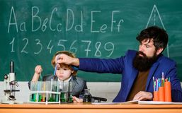Biotechnology research concept. son and father at school. Formula. experiments in organic laboratory. Wisdom. Back to stock images