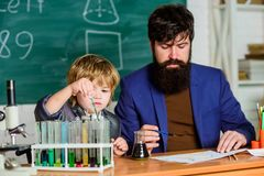Biotechnology research concept. Wisdom. Back to school. Formula. experiments in organic chemistry laboratory. small boy. With teacher man. son and father at royalty free stock photo