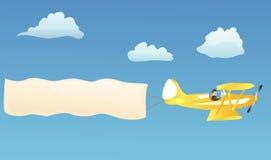 Biplan avec le drapeau blanc Photographie stock libre de droits