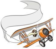 Biplan de dessin animé de vecteur avec le drapeau Photo stock