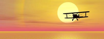 Biplan sobre el océano Imagen de archivo libre de regalías
