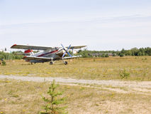 Biplane. Small rural air station with plane Stock Photo