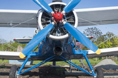 Biplane blue color front view. Biplane blue color front close-up view Stock Photos