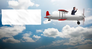 The biplane with businessman and blank banner Royalty Free Stock Images