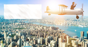 The biplane with businessman and blank banner Royalty Free Stock Photo