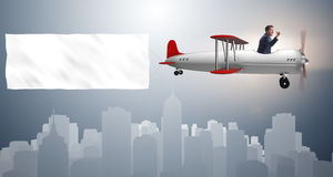 The biplane with businessman and blank banner Stock Images