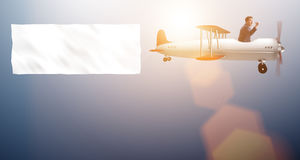 The biplane with businessman and blank banner Royalty Free Stock Image