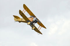 Biplane fighter flyingon sky Royalty Free Stock Images