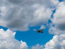 A Biplane in Flight Stock Photo