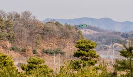 Biplane flying over mountainous region. Chungju, South Korea, February 22, 2018: ROK military biplane training aircraft flying over mountainous region on Royalty Free Stock Image