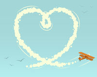 Biplane with heart shape Stock Photography