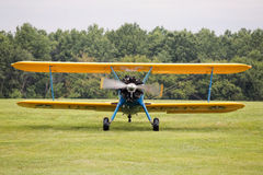 Biplane landing on field Royalty Free Stock Images