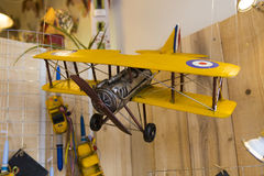 Biplane layout. Old biplane layout toy in a shop Royalty Free Stock Photo