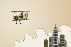 Biplane near skyscrapers Royalty Free Stock Photo