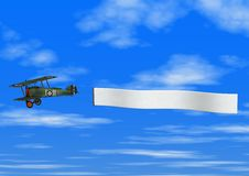 Biplane pulling banner on Sky Background Stock Images