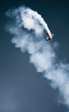 Biplane showing aerobatics figure royalty free stock photo