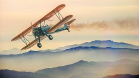 Biplane on sky Stock Images
