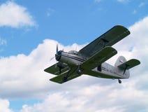 Biplane in the sky. Old biplane in the sky Royalty Free Stock Image
