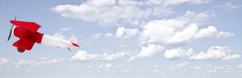 Biplane in the sky with clouds Royalty Free Stock Images