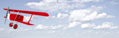 Biplane in the sky with clouds Royalty Free Stock Image