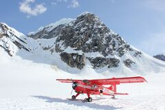 Biplane on snowy mountain Royalty Free Stock Photo