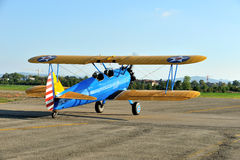 Biplane stearman on takeoff Stock Image