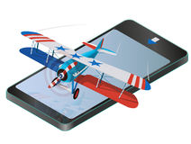 Biplane from World War on mobile phone with colors of flag of United States. Royalty Free Stock Image