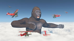 Biplanes attack a giant gorilla Stock Image