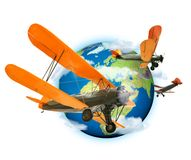 Biplanes flying around the planet Earth. Travel and transport concept royalty free stock photography