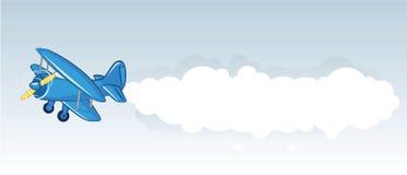 Biplano azul con la bandera Foto de archivo libre de regalías