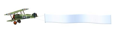 Biplano con la bandiera in bianco - include il percorso di residuo della potatura meccanica Fotografie Stock Libere da Diritti