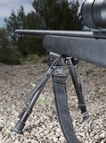 Bipod. Rifle on a ridgeline that is stabilized on a bipod Stock Image