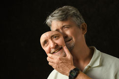 Bipolaire wanorde gedeprimeerde mens met masker Stock Foto
