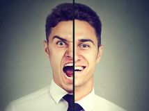 Bipolar disorder. Business man with double face expression royalty free stock photography