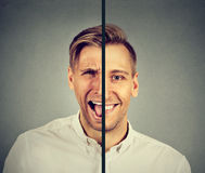Bipolar disorder concept. Young man with double face expression royalty free stock photos