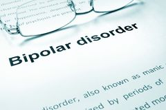 Bipolar disorder sign on a paper. Bipolar disorder sign on a paper and glasses royalty free stock photo