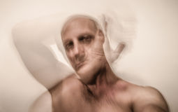 Bipolar man victim of schizophrenia Royalty Free Stock Images