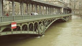 Bir-Hakeim Bridge Paris Cinematic. PARIS, FRANCE - JAN 30, 2018: Statue on the Pont de Bir-Hakeim and swollen river Seine embankments overflow flooding in Paris stock video
