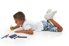 Biracial boy coloring Royalty Free Stock Photo