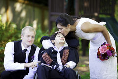 Biracial bride kissing her little brother on her wedding day. Ch Royalty Free Stock Photos