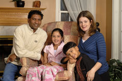 Biracial Family Portrait. Portrait of an Asian-Indian father, caucasian-American mother and their 2 children in their family home
