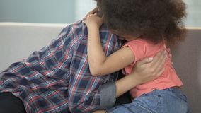 Biracial girl hugging mother, rejoicing that finally found her, adoption system stock video
