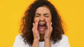 Biracial girl screaming loudly to camera, social problem awareness, closeup. Stock footage stock video footage