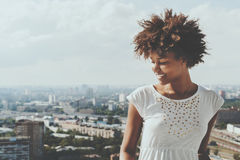 Biracial smiling curly female teenager on balcony Stock Photography