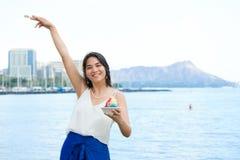 Biracial teen girl holding shave ice in Waikiki, Honolulu, Hawai Stock Photo