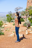 Biracial teen girl raising arms in praise at the Grand Canyon Royalty Free Stock Images